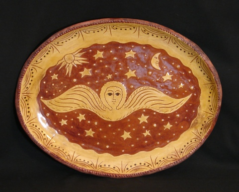 oval redware platter, angel with moon and sun