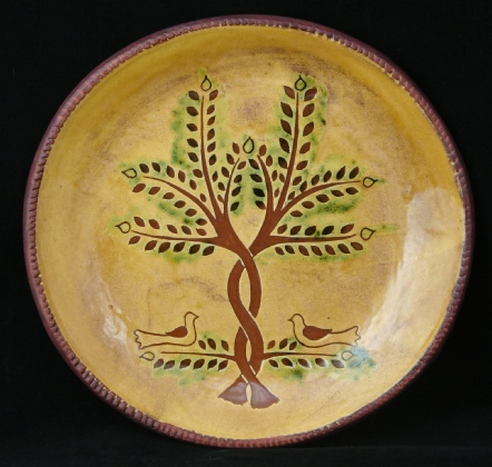 redware charger, doves and trees