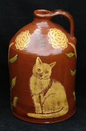 redware gallon jug, cat and trees