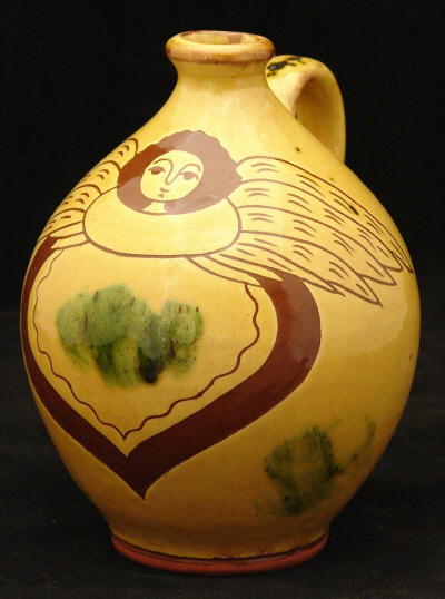 redware jug, angel with wings