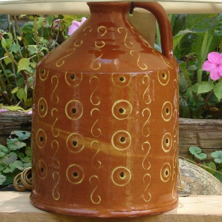 redware lamp with circles and dots pattern