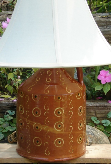 redware lamp, circles and dots
