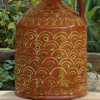 redware lamp with peacock feathers pattern