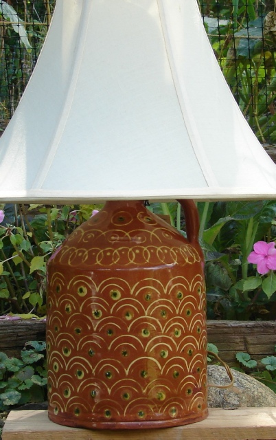 redware lamp, peacock feathers