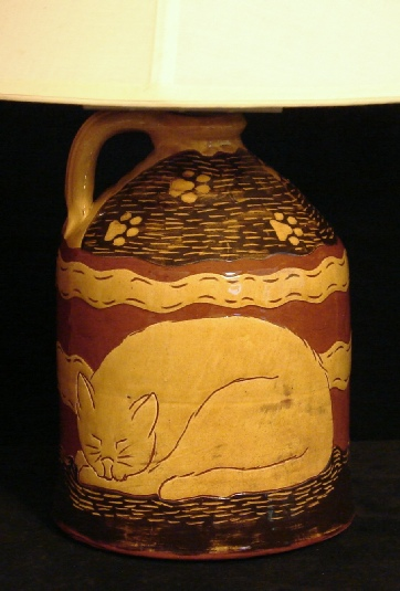 redware lamp, sleeping cat