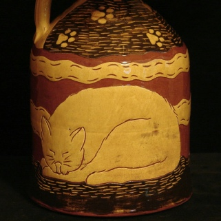 redware lamp with sleeping cat pattern