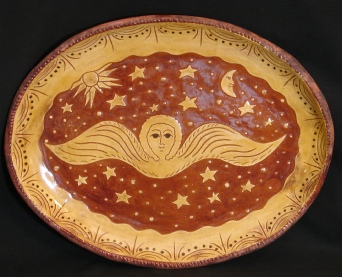 redware oval platter, angel with sun, moon and stars