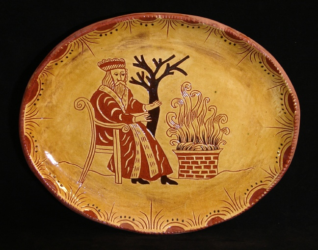 redware oval platter, father christmas by the fire