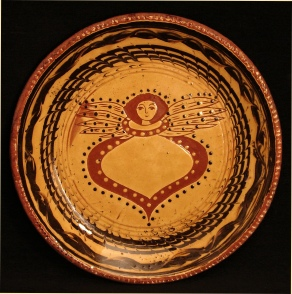 redware plate, angel with wings and mabled border