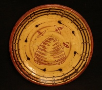redware plate, bess skep and mabled border