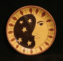 redware plate, man in the moon