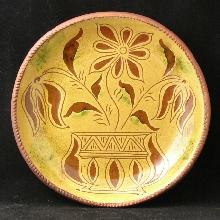 redware plate, tulips in vase