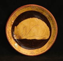 redware plate, sleeping cat
