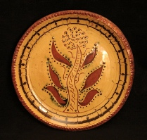 redware plate, tree and mabled border