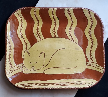 redware platter, sleeping cat