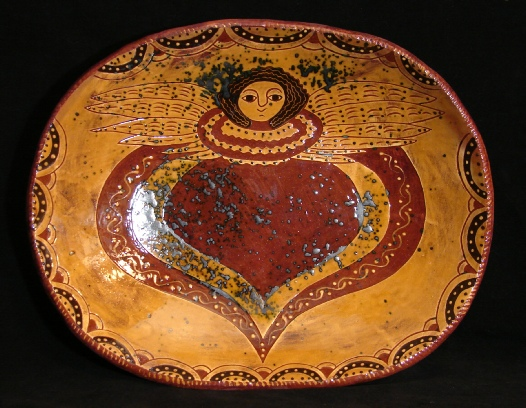 redware trencher, angel with wings