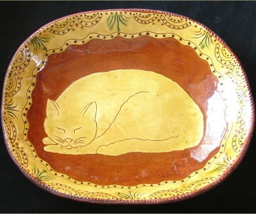 redware trencher, sleeping cat